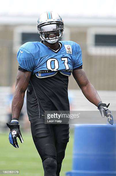 Calvin Johnson of the Detroit Lions works out during the morning practice sessions on August 14, 2012 in Allen Park, Michigan.
