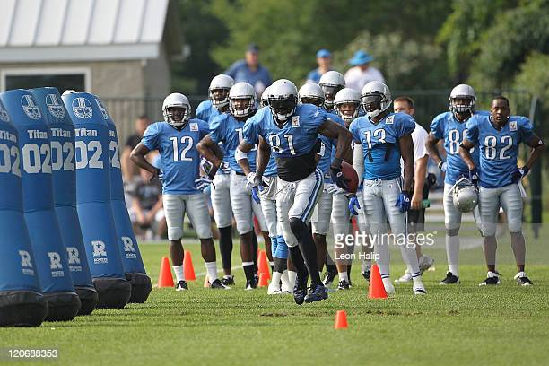 Calvin Johnson of the Detroit Lions works out during Training Camp at the Detroit Lions Headquarters and Training Facility on August 8, 2011 in Allen...