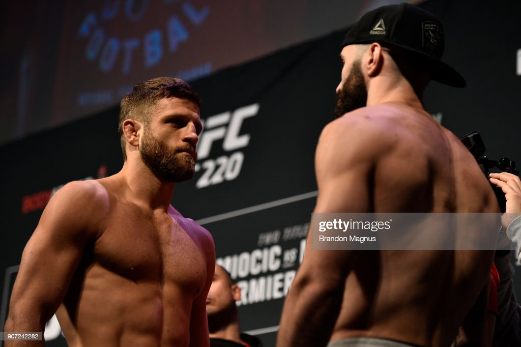 Calvin Kattar and Shane Burgos face off during the UFC 220 weigh-in at TD Garden on January 19, 2018 in Boston, Massachusetts.