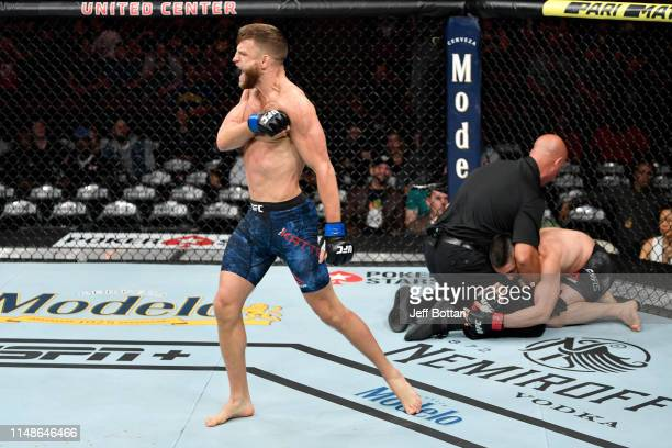 Calvin Kattar celebrates his KO victory over Ricardo Lamas in their featherweight bout during the UFC 238 event at the United Center on June 8, 2019...