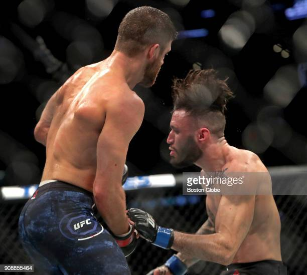 Calvin Kattar left drops Shane Burgos to the canvas en route to a win in a Featherweights match during UFC 220 at TD Garden in Boston on Jan 20 2018