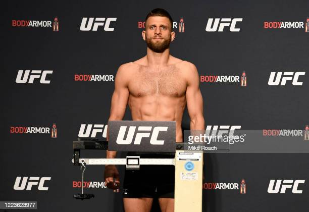 Calvin Kattar poses on the scale during the UFC 249 official weighin on May 08 2020 in Jacksonville Florida