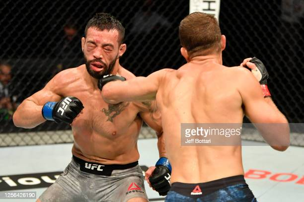 Calvin Kattar punches Dan Ige in their featherweight fight during the UFC Fight Night event inside Flash Forum on UFC Fight Island on July 16, 2020...
