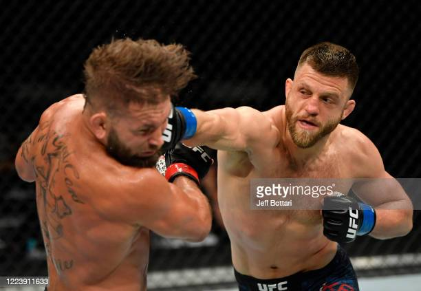 Calvin Kattar punches Jeremy Stephens in their featherweight fight during the UFC 249 event at VyStar Veterans Memorial Arena on May 09 2020 in...