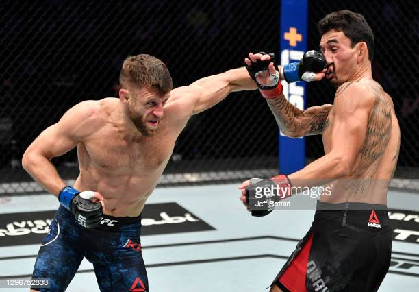 Calvin Kattar punches Max Holloway in a featherweight bout during the UFC Fight Night event at Etihad Arena on UFC Fight Island on January 17, 2021...