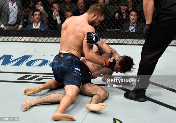 Calvin Kattar punches Shane Burgos in their featherweight bout during the UFC 220 event at TD Garden on January 20 2018 in Boston Massachusetts