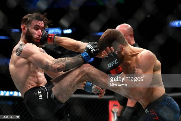 Calvin Kattar throws a punch against Shane Burgos in their Featherweight fight during UFC 220 at TD Garden on January 20 2018 in Boston Massachusetts