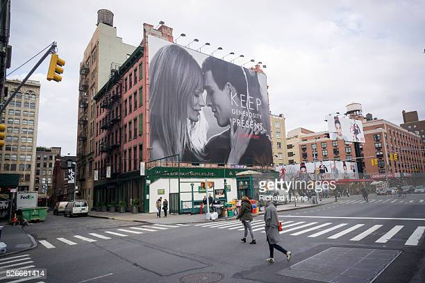 Calvin Klein billboard in the Soho neighborhood of New York provides a secular take on the holiday season promoting gift giving. The advertisement is...