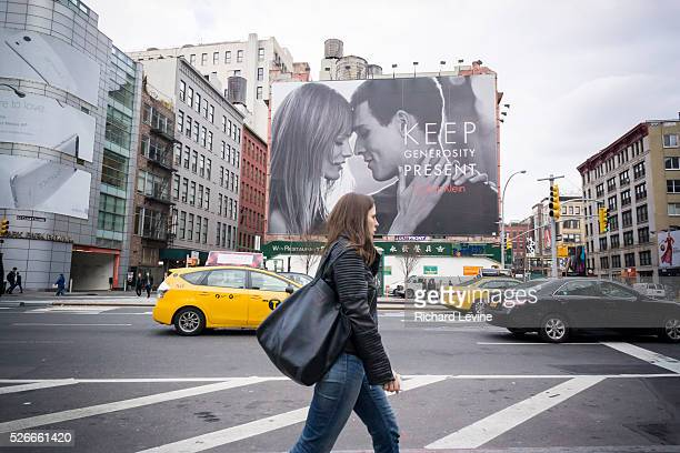 A Calvin Klein billboard in the Soho neighborhood of New York provides a secular take on the holiday season promoting gift giving The advertisement...