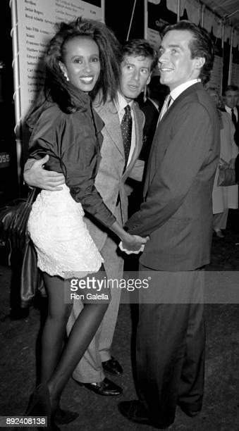 Calvin Klein Iman and Willy Regan attend Fete de Famille AIDS Benefit on October 1 1987 at Mortimer's Restaurant in New York City