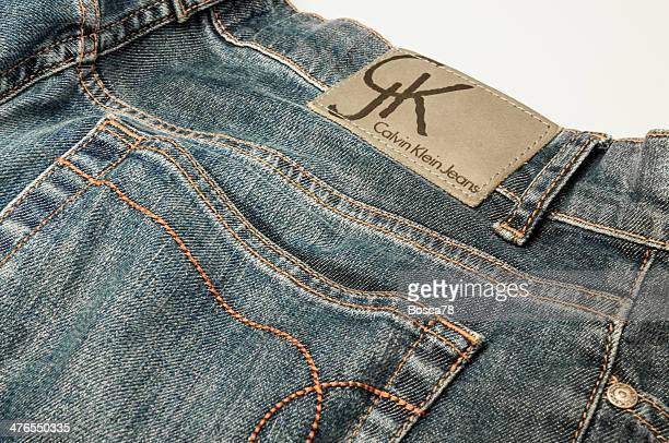 calvin klein jeans denim trousers closeup - calvin klein designer label stock photos and pictures