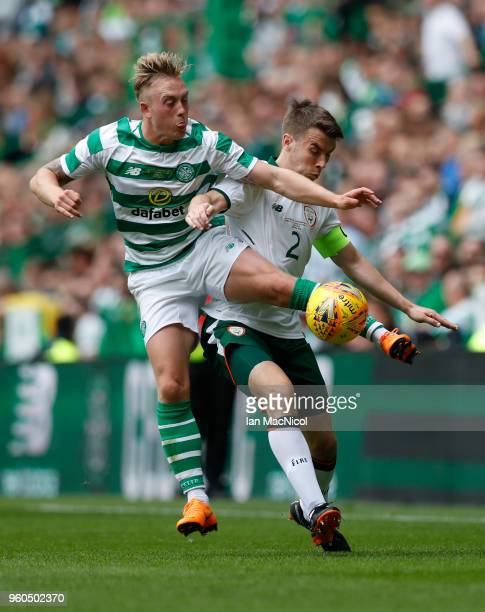 Calvin Miller of Celtic vies with Seamas Coleman during the Scott Brown testimonial match between Celtic and Republic of Ireland XI at Celtic Park on...