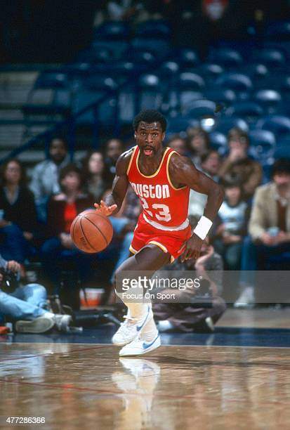 Calvin Murphy of the Houston Rockets dribbles the ball up court against the Washington Bullets during an NBA basketball game circa 1980 at the...