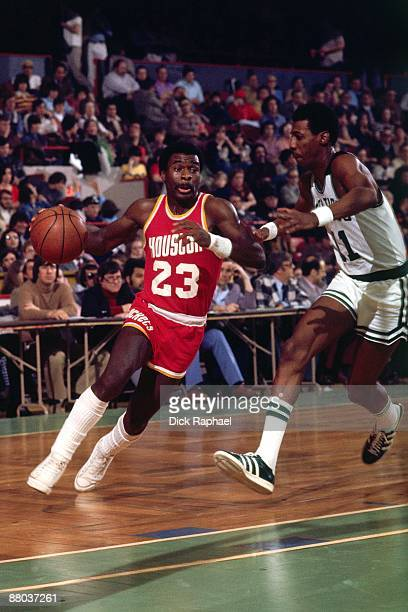 Calvin Murphy of the Houston Rockets drives to the basket against Charlie Scott of the Boston Celtics during a game played in 1976 at the Boston...