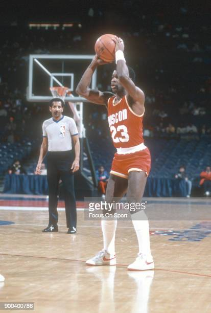 Calvin Murphy of the Houston Rockets looks to pass the ball against the Washington Bullets during an NBA basketball game circa 1981 at the Capital...
