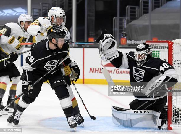 Calvin Petersen of the Los Angeles Kings makes a glove save in front of Tomas Nosek of the Vegas Golden Knights and Sean Walker during the first...