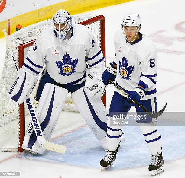Calvin Pichard and Travis Dermott of the Toronto Marlies watch the play develop against the Laval Rocket during AHL game action on October 28 2017 at...