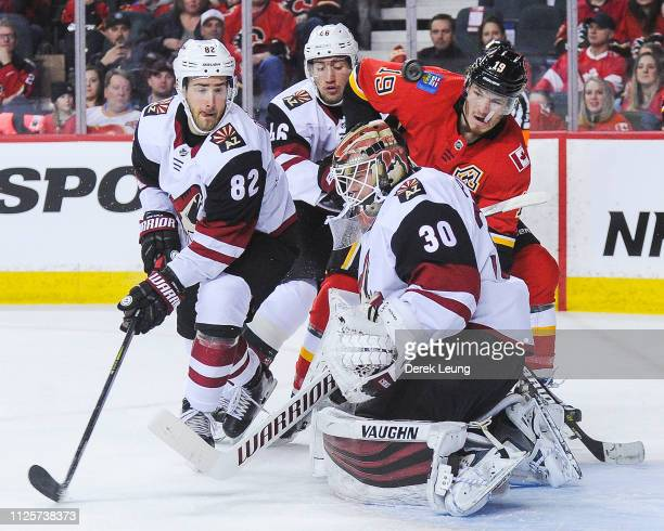 Calvin Pickard of the Arizona Coyotes stops a shot from the Calgary Flames during an NHL game at Scotiabank Saddledome on February 18 2019 in Calgary...