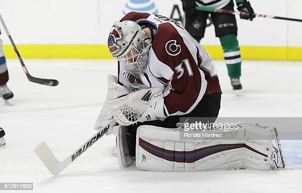 Calvin Pickard of the Colorado Avalanche makes a save against the Dallas Stars in the third period during a preseason game at American Airlines...