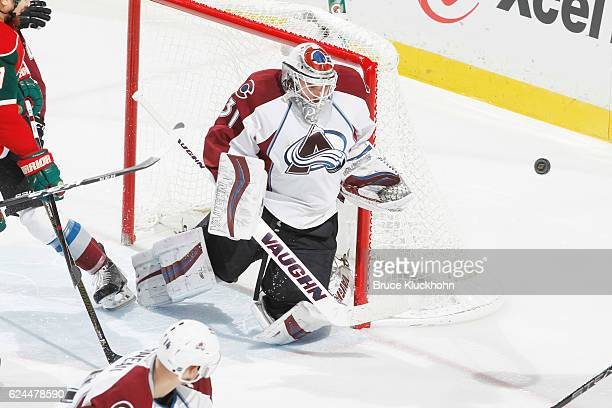 Calvin Pickard of the Colorado Avalanche makes a save against the Minnesota Wild during the game on November 19 2016 at the Xcel Energy Center in St...