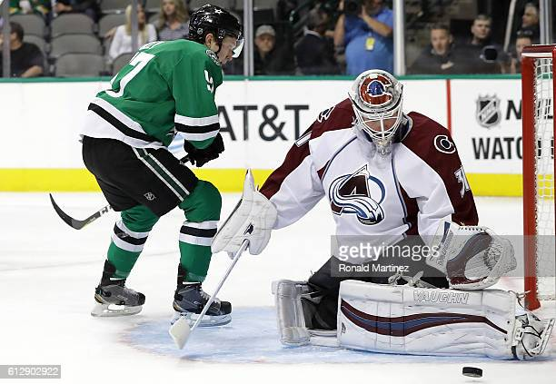 Calvin Pickard of the Colorado Avalanche makes a save in front of Cole Ully of the Dallas Stars during a preseason game at American Airlines Center...