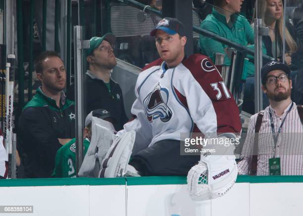 Calvin Pickard of the Colorado Avalanche watches the action from the bench against the Dallas Stars at the American Airlines Center on April 8 2017...