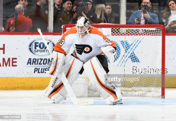 Calvin Pickard of the Philadelphia Flyers gets ready to make a save against the Arizona Coyotes at Gila River Arena on November 5 2018 in Glendale...