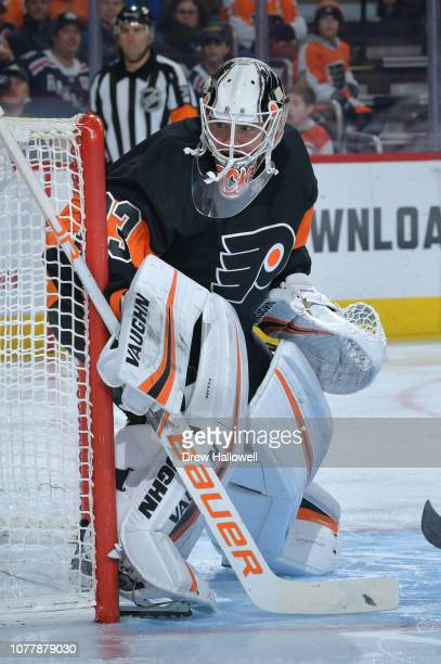 Calvin Pickard of the Philadelphia Flyers looks on against the New York Rangers at Wells Fargo Center on November 23 2018 in Philadelphia Pennsylvania
