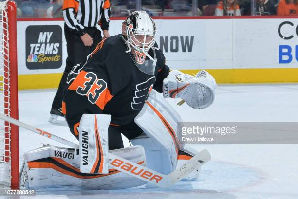 Calvin Pickard of the Philadelphia Flyers looks on against the New York Rangers at Wells Fargo Center on November 23 2018 in Philadelphia...