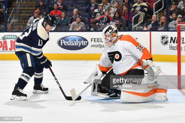 Calvin Pickard of the Philadelphia Flyers stops a shot by Cam Atkinson of the Columbus Blue Jackets during the first period on October 18 2018 at...