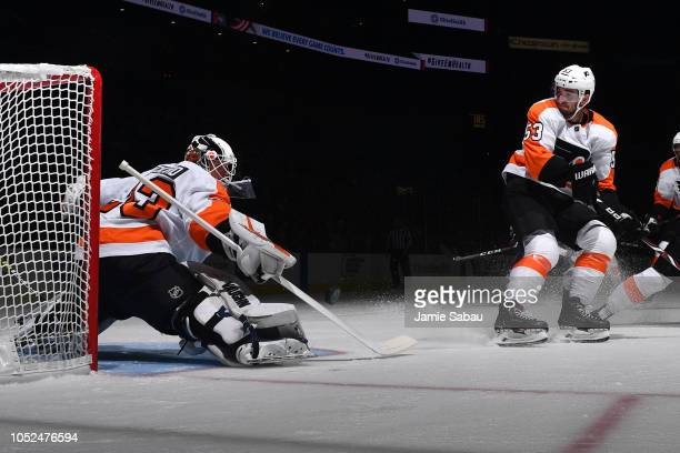 Calvin Pickard of the Philadelphia Flyers stops a shot during the first period of the game against the Columbus Blue Jackets on October 18 2018 at...