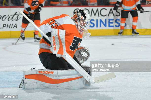 Calvin Pickard of the Philadelphia Flyers warms up before the game against the San Jose Sharks at the Wells Fargo Center on October 9 2018 in...