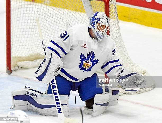 Calvin Pickard of the Toronto Marlies stops a shot against the Manitoba Moose during AHL game action on December 17 2017 at Ricoh Coliseum in Toronto...