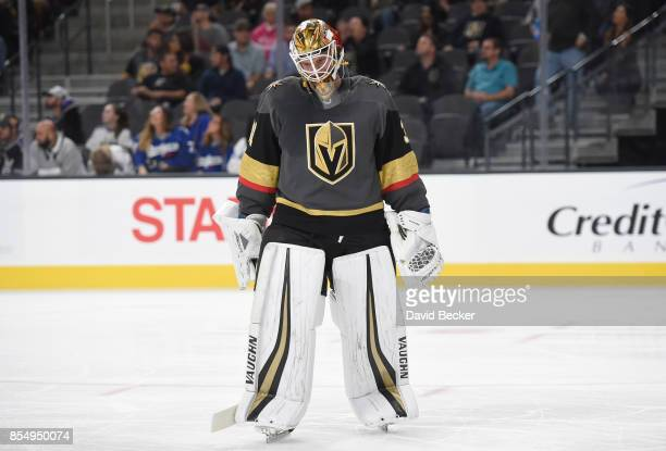 Calvin Pickard of the Vegas Golden Knights looks on during a preseason game against the Los Angeles Kings at TMobile Arena on September 26 2017 in...