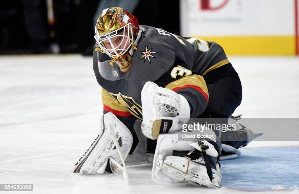 Calvin Pickard of the Vegas Golden Knights stretches during a preseason game against the Los Angeles Kings at TMobile Arena on September 26 2017 in...