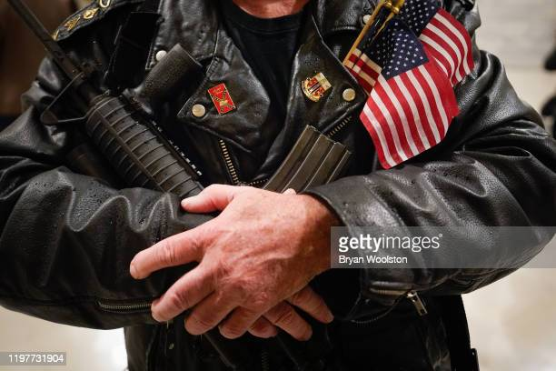 Calvin Pinkston of Louisville Ky stands in the rotunda of the State Capitol holding a semiautoimaric rifle on January 31 2020 in Frankfort Kentucky...