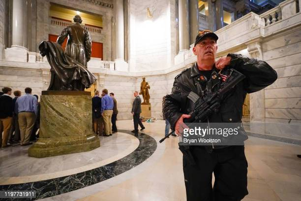 Calvin Pinkston of Louisville Ky walks in the rotunda of the State Capitol carrying a semiautoimaric rifle on January 31 2020 in Frankfort Kentucky...