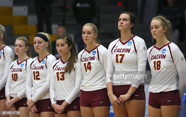 Calvin Players stand for the playing of the National Anthem before the start of the Division III Women's Volleyball Championship held at the Kolf...