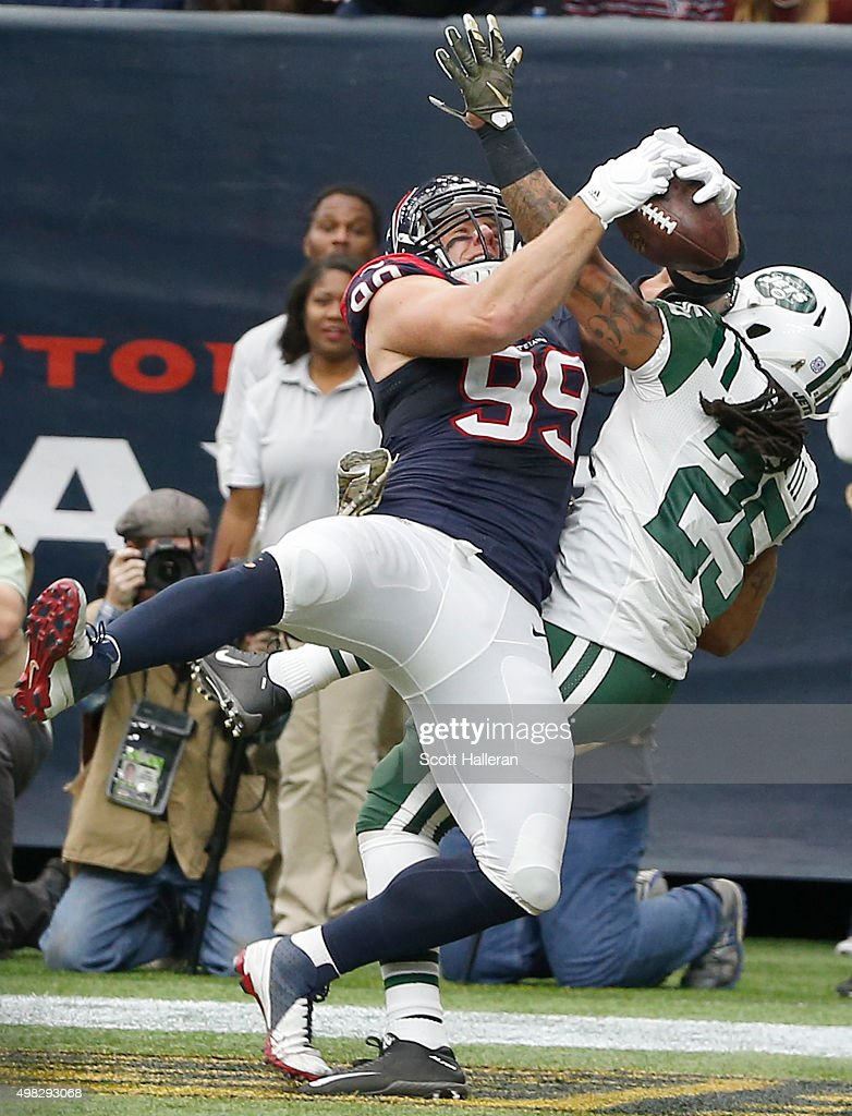 Calvin Pryor #25 of the New York Jets has his pass broken up by J.J. Watt #99 of the Houston Texans in the first quarter on November 22, 2015 at NRG Stadium in Houston, Texas.