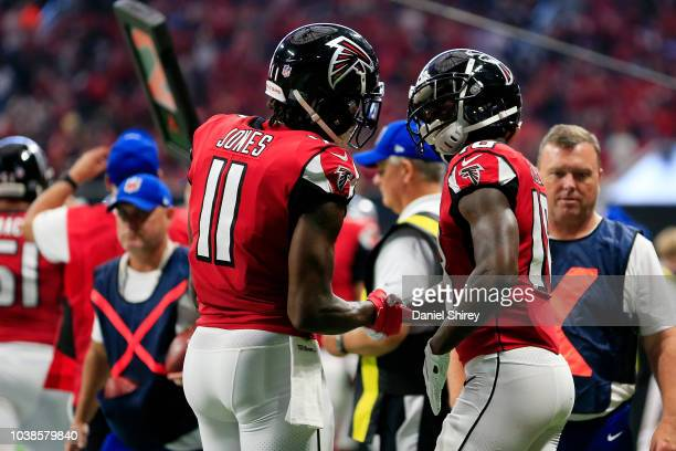 Calvin Ridley celebrates a touchdown with Julio Jones of the Atlanta Falcons during the third quarter against the New Orleans Saints at MercedesBenz...