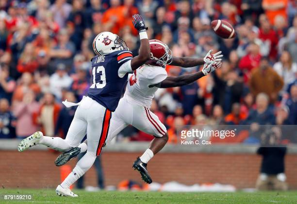 Calvin Ridley of the Alabama Crimson Tide ails to catch a pass defended by Javaris Davis of the Auburn Tigers during the first quarter of the game at...