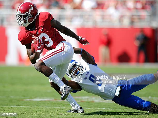 Calvin Ridley of the Alabama Crimson Tide attempts to break a tackle by Isiah Upton of the Middle Tennessee Blue Raiders at BryantDenny Stadium on...