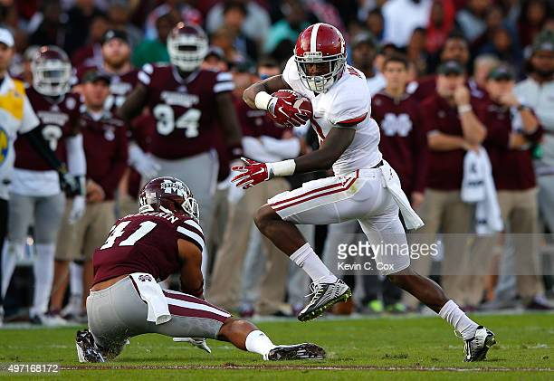 Calvin Ridley of the Alabama Crimson Tide breaks a tackle attempt by Mark McLaurin of the Mississippi State Bulldogs on the way to a touchdown at...