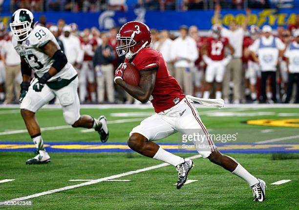Calvin Ridley of the Alabama Crimson Tide carries the ball in the fourth quarter against the Michigan State Spartans during the Goodyear Cotton Bowl...