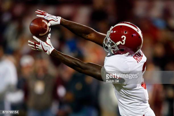 Calvin Ridley of the Alabama Crimson Tide catches a pass as he warms up before the first half of an NCAA football game against the Mississippi State...
