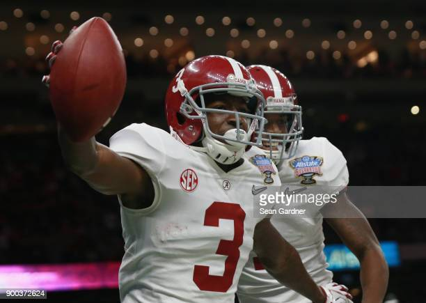 Calvin Ridley of the Alabama Crimson Tide celebrates a reception for a touchdown with teammates in the first quarter of the AllState Sugar Bowl...