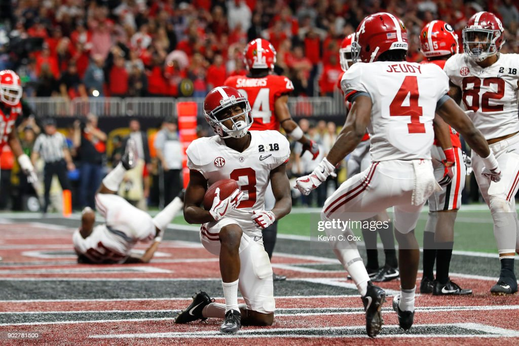Calvin Ridley #3 of the Alabama Crimson Tide celebrates a seven yard touchdown catch during the fourth quarter against the Georgia Bulldogs in the CFP National Championship presented by AT&T at Mercedes-Benz Stadium on January 8, 2018 in Atlanta, Georgia.
