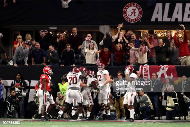 Calvin Ridley of the Alabama Crimson Tide celebrates a seven yard touchdown catch during the fourth quarter against the Georgia Bulldogs in the CFP...