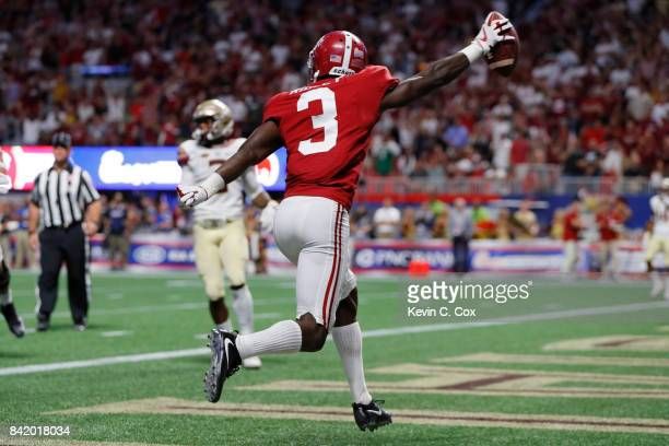 Calvin Ridley of the Alabama Crimson Tide celebrates after scoring on a twopoint conversion against the Florida State Seminoles during their game at...