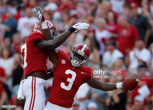 Calvin Ridley of the Alabama Crimson Tide celebrates his touchdown reception against the Colorado State Rams with Cam Sims at BryantDenny Stadium on...